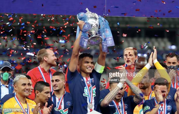 Captain Thiago Silva of PSG lifts the cup after the French Cup Final match between Paris Saint Germain and Saint Etienne at Stade de France on July...