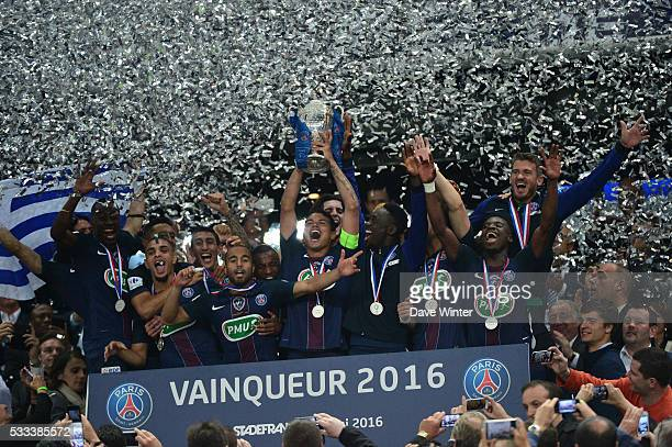 PSG captain Thiago Silva of PSG lifts the trophy following victory in the French Cup Final between Paris Saint Germain and Marseille at Stade de...