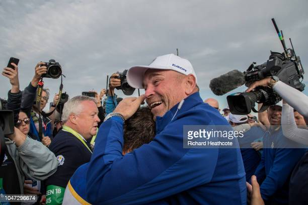 Captain Thomas Bjorn hugs Francesco Molinari as he secures the winning point to take the victory during the singles matches of the 2018 Ryder Cup at...