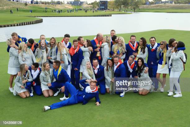 Captain Thomas Bjorn kisses girlfriend Grace Barber as he holds The Ryder Cup as Europe celebrate victory following the singles matches of the 2018...