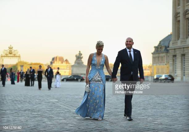 Captain Thomas Bjorn of Europe and partner Grace Barber walk in after arriving at the Palace of Versailles for the Ryder Cup Gala dinner ahead of the...