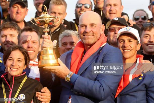 Captain Thomas Bjorn of Europe celebrates with The Ryder Cup after singles matches of the 2018 Ryder Cup at Le Golf National on September 30 2018 in...