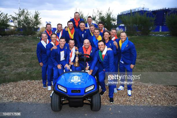 Captain Thomas Bjorn of Europe holds The Ryder Cup as Europe celebrate victory following the singles matches of the 2018 Ryder Cup at Le Golf...