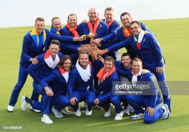 Captain Thomas Bjorn of Europe holds The Ryder Cup as The European Team celebrate victory following the singles matches of the 2018 Ryder Cup at Le...