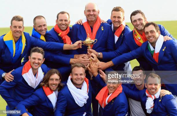 Captain Thomas Bjorn of Europe holds The Ryder Cup trophy as The European Team celebrate victory following the singles matches of the 2018 Ryder Cup...