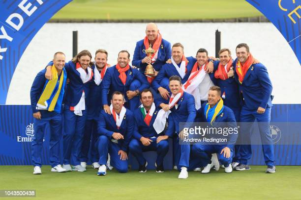 Captain Thomas Bjorn of Europe lifts The Ryder Cup as Europe celebrates victory following the singles matches of the 2018 Ryder Cup at Le Golf...