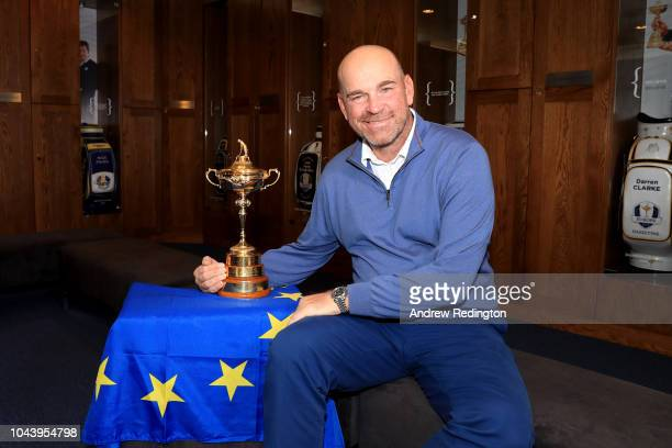 Captain Thomas Bjorn of Europe pose for a photo with The Ryder Cup during a press conference following Europe's win in the 2018 Ryder Cup at Le Golf...
