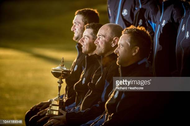 Captain Thomas Bjorn of Europe poses alongside Rory McIlroy Jon Rahm and Ian Poulter during a European Team photocall ahead of the 2018 Ryder Cup at...