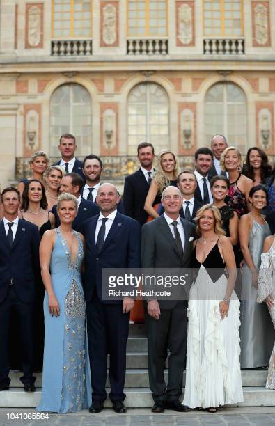 Captain Thomas Bjorn of Europe poses with girlfriend Grace Barber next to captain Jim Furyk of the United States and wife Tabitha Furyk on the steps...