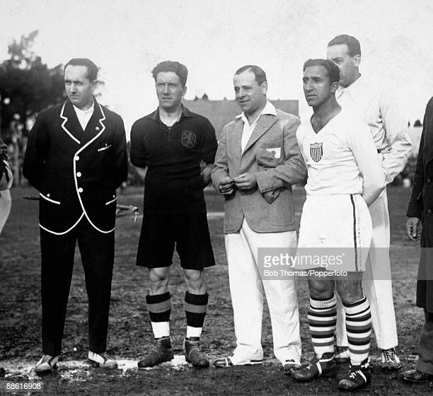 USA captain Thomas Florie and Belgium's Pierre Braine stand alongside the match referee Jose Macias and the linsemen prior to the FIFA World Cup...