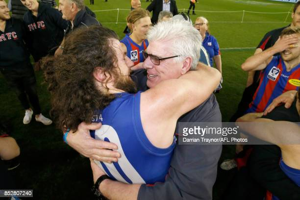 Captain Toby Pinwill of Port Melbourne and Gary Ayres senior coach embrace after the VFL Grand Final match between Richmond and Port Melbourne at...
