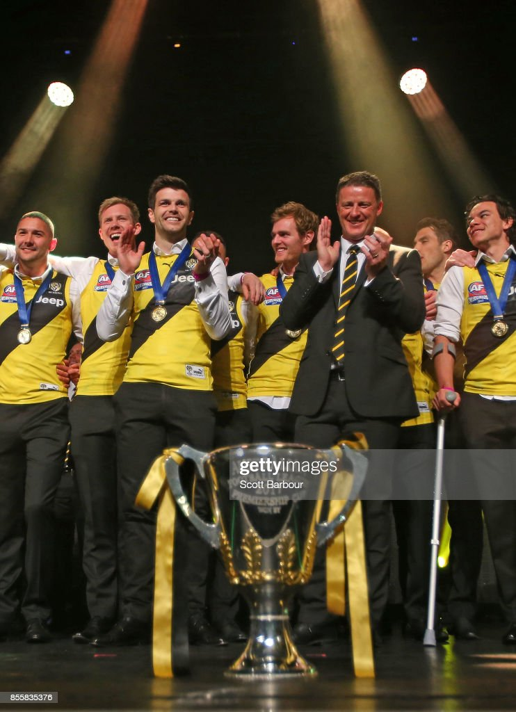 Captain Trent Cotchin of the Tigers and Damien Hardwick, coach of the Tigers smile as the Tigers celebrate with the AFL Premiership Cup on stage during the Richmond Tigers AFL Grand Final celebrations at Crown Entertainment Complex on September 30, 2017 in Melbourne, Australia.