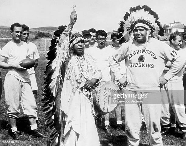 Captain Turk Edwards of the Washington Redskins professional football team is made an honorary member of the Spokane tribe by Chief Black Spirit with...
