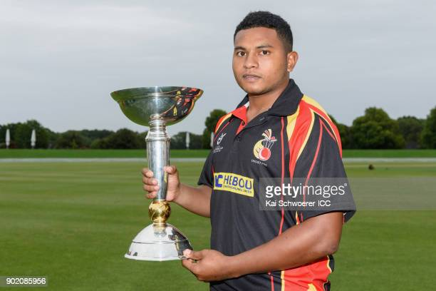 Captain Vagi Karaho of Papua New Guinea poses with the ICC U19 World Cup trophy during the ICC U19 Cricket World Cup Opening Ceremony on January 7...