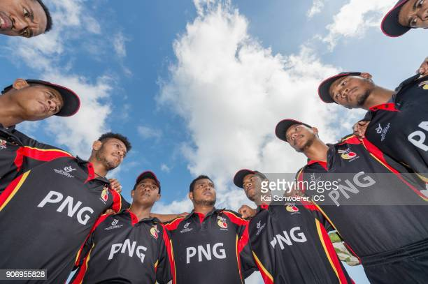 Captain Vagi Karaho of Papua New Guinea speaks to his team mates prior to the ICC U19 Cricket World Cup match between Australia and PNG at Lincoln...