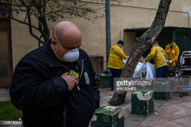 TOPSHOT Captain Villegas of the LAFD Station No9 talks on his radio while paramedics cover the body of an unidentified homeless woman who died of...