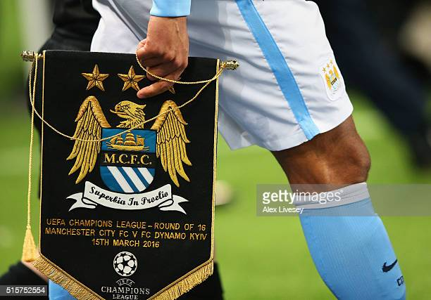Captain Vincent Kompany of Manchester City carries a pennant prior to the UEFA Champions League round of 16 second leg match between Manchester City...