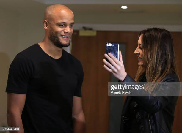 Captain Vincent Kompany of Manchester City celebrates his team Manchester City winning The 2017/18 Premier League during an interview at The Marriott...
