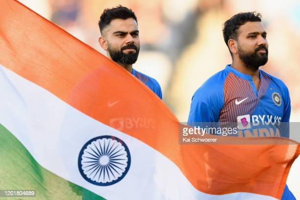 Captain Virat Kohli and vice-captain Rohit Sharma of India line up for their national anthem prior to game one of the Twenty20 series between New...