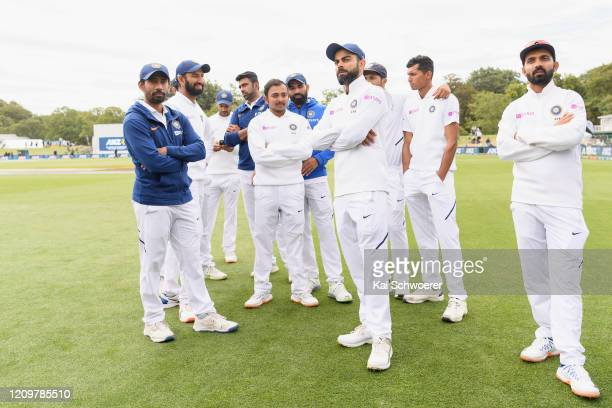 Captain Virat Kohli of India and his team mates look dejected after their loss on day three of the Second Test match between New Zealand and India at...