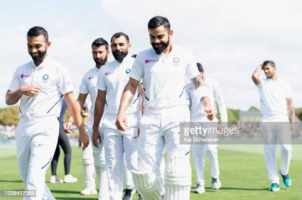 Captain Virat Kohli of India and his team mates look on during day one of the Second Test match between New Zealand and India at Hagley Oval on...