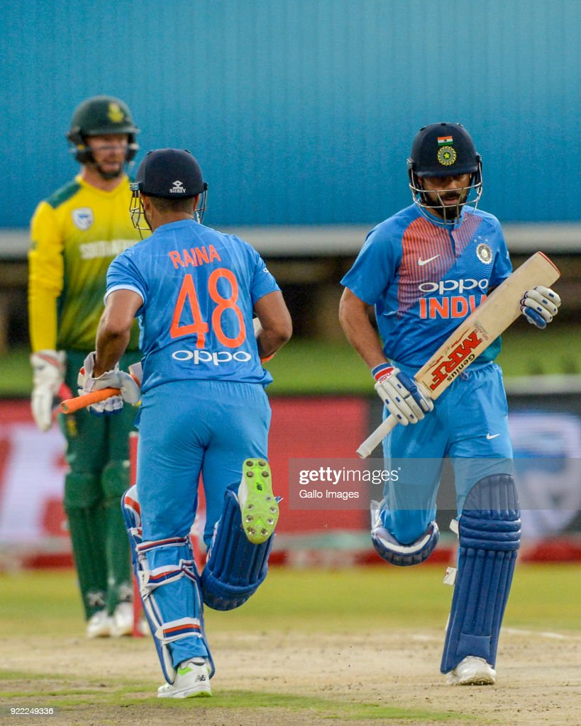 Captain Virat Kohli of India and Suresh Raina of India during the 2nd KFC T20 International match between South Africa and India at SuperSport Park on February 21, 2018 in Pretoria, South Africa.
