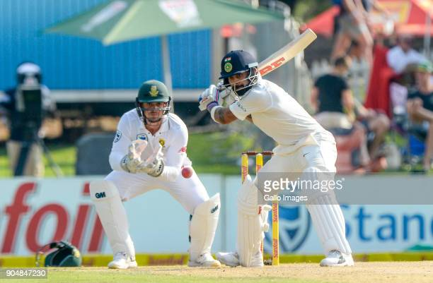 /Captain Virat Kohli of India and wicketkeeper Quinton de Kock of South Africa during day 2 of the 2nd Sunfoil Test match between South Africa and...