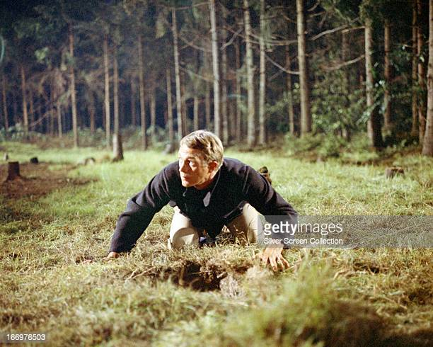 Captain Virgil Hilts played by American actor Steve McQueen emerges from a tunnel in 'The Great Escape' directed by John Sturges 1963