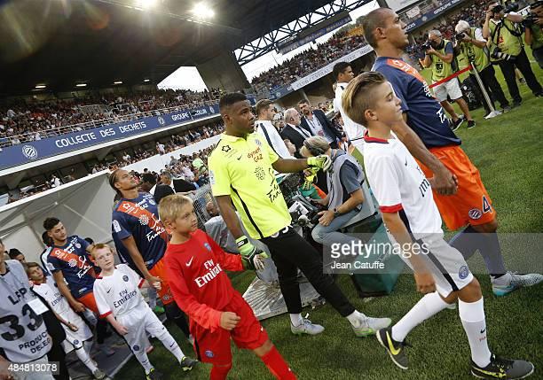 Captain Vitorino Hilton of Montpellier leads goalkeeper of Montpellier Jonathan Ligali Daniel Congre of Montpellier to enter the field before the...
