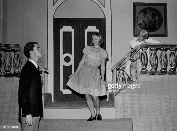 Captain von Trapp Awaits Maria as she comes Down Stairway This is a scene from South High School production of Sound of Music Charles Warnberg plays...