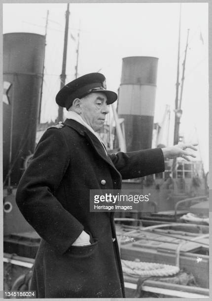 Captain W. R. Crouch, Dockmaster at Tilbury Docks, directing operations in the lock as the cooling water intake caisson for Coryton Oil Refinery...