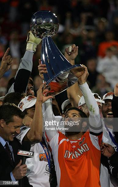 Captain Wade Barrett of the Houston Dynamo hoists the Alan I. Rothenberg Trophy after winning MLS Cup 2006 against the New England Revolution in...