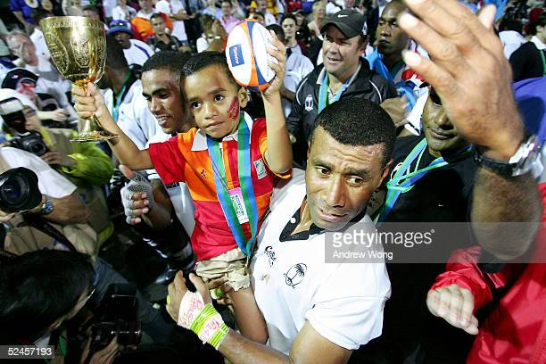 Captain Waisale Serevi of Fiji and his son Serevi Jr celebrate after after defeating New Zealand in the Melrose Cup Final on day three of the Rugby...
