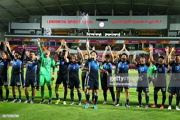Captain Wataru Endo and Japanese players celebrate qualifying for the Rio de Janeiro Olympics after winning the AFC U23 Championship semi final match...