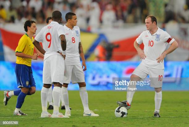 Captain Wayne Rooney Jermaine Jenas and Darren Bent of England look dejected after Brazil's first goal during the International Friendly match...