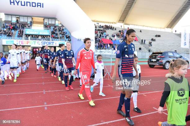 Captain Wendie Renard of Lyon leads her team out for the Division 1 match between Paris FC and Lyon on January 14 2018 in Evry Bondoufle France