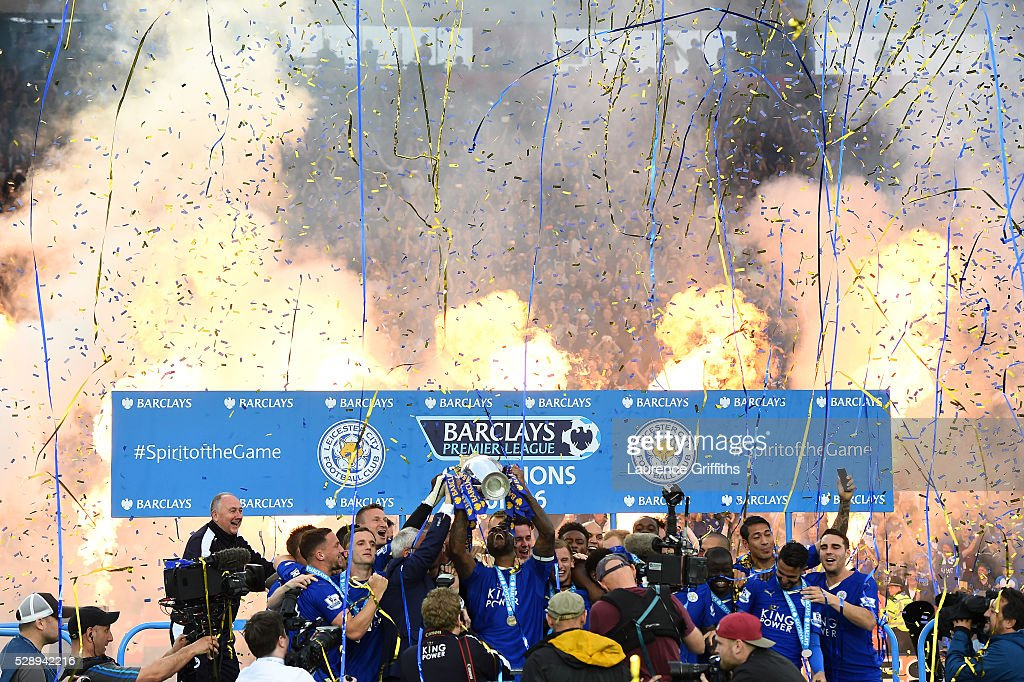 Captain Wes Morgan and manager Claudio Ranieri of Leicester City lift the Premier League Trophy as players and staffs celebrate the season champions after the Barclays Premier League match between Leicester City and Everton at The King Power Stadium on May 7, 2016 in Leicester, United Kingdom.