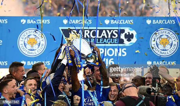 Captain Wes Morgan and manager Claudio Ranieri of Leicester City lift the Premier League Trophy after the Barclays Premier League match between...