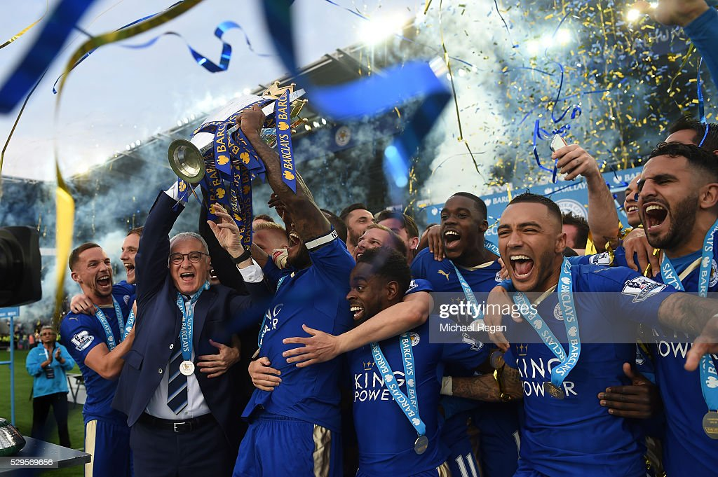 Captain Wes Morgan and manager Claudio Ranieri of Leicester City lift the Premier League Trophy after the Barclays Premier League match between Leicester City and Everton at The King Power Stadium on May 7, 2016 in Leicester, United Kingdom.