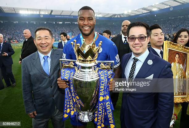 Captain Wes Morgan of Leicester City and Chairman Vichai Srivaddhanaprabha and Vice chairman Aiyawatt Srivaddhanaprabha of Leicester City with the...