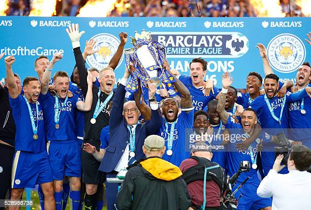 Captain Wes Morgan of Leicester City and manager Claudio Ranieri of Leicester City lift the Premier League trophy at the King Power Stadium on May...