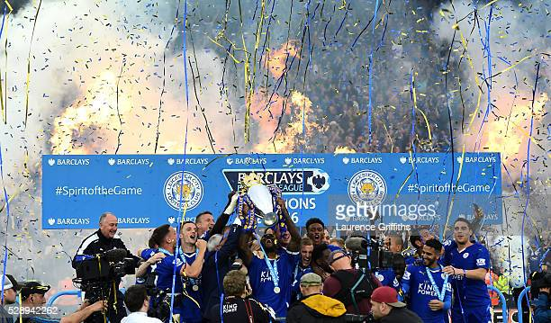 Captain Wes Morgan of Leicester City lifts the Premier League Trophy as players and staffs celebrate the season champions after the Barclays Premier...