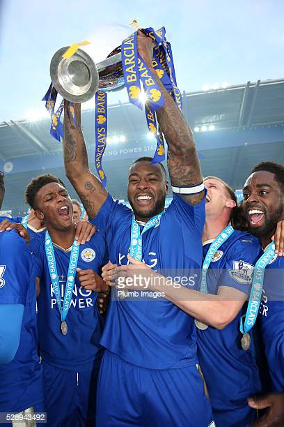 Captain Wes Morgan of Leicester City lifts the Premier League trophy after the Barclays Premier League match between Leicester City and Everton at...