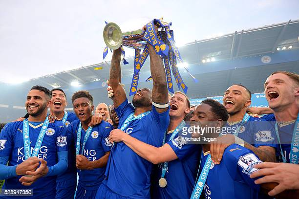Captain Wes Morgan of Leicester City lifts the Premier League Trophy as players celebrate the season champions after the Barclays Premier League...