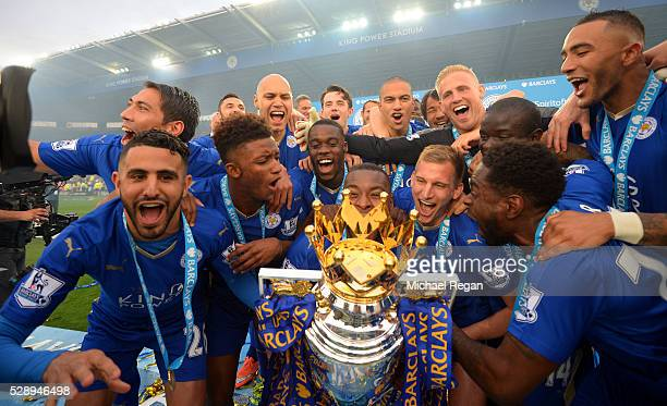 Captain Wes Morgan of Leicester City to lift the Premier League Trophy as players celebrate the season champions after the Barclays Premier League...