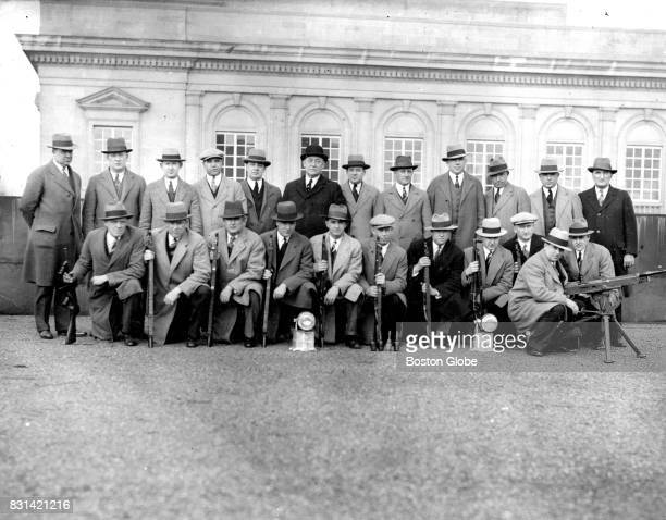 """Captain William W. Livingston's """"Flying Squadron"""" unit of the Boston Police Department is pictured circa May 1929. Kneeling left to right are Special..."""