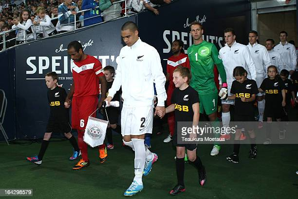 Captain Winston Reid of the New Zealand All Whites leads the team out before the FIFA World Cup Qualifier match between the New Zealand All Whites...