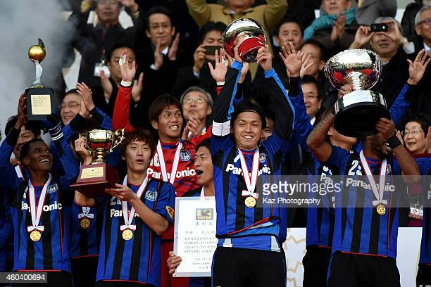 Captain Yasuhito Endo holds up the Emperor's Cup during the Emperor's Cup final match between Gamba Osaka and Montedio Yamagata at Nissan Stadium on...