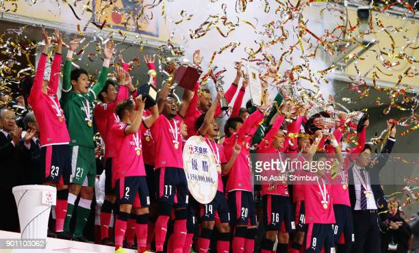 Captain Yoichiro Kakitani of Cerezo Osaka lifts the trophy after the 97th Emperor's Cup All Japan Football Championship final between Cerezo Osaka...