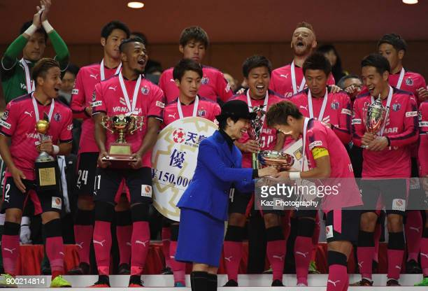 Captain Yoichiro Kakitani of Cerezo Osaka receives the Emperor's Cup during the 97th All Japan Football Championship final between Cerezo Osaka and...